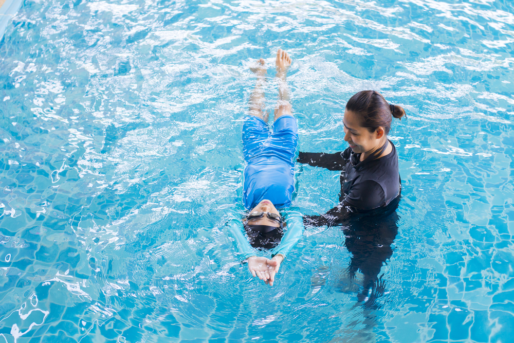 person learning swimming