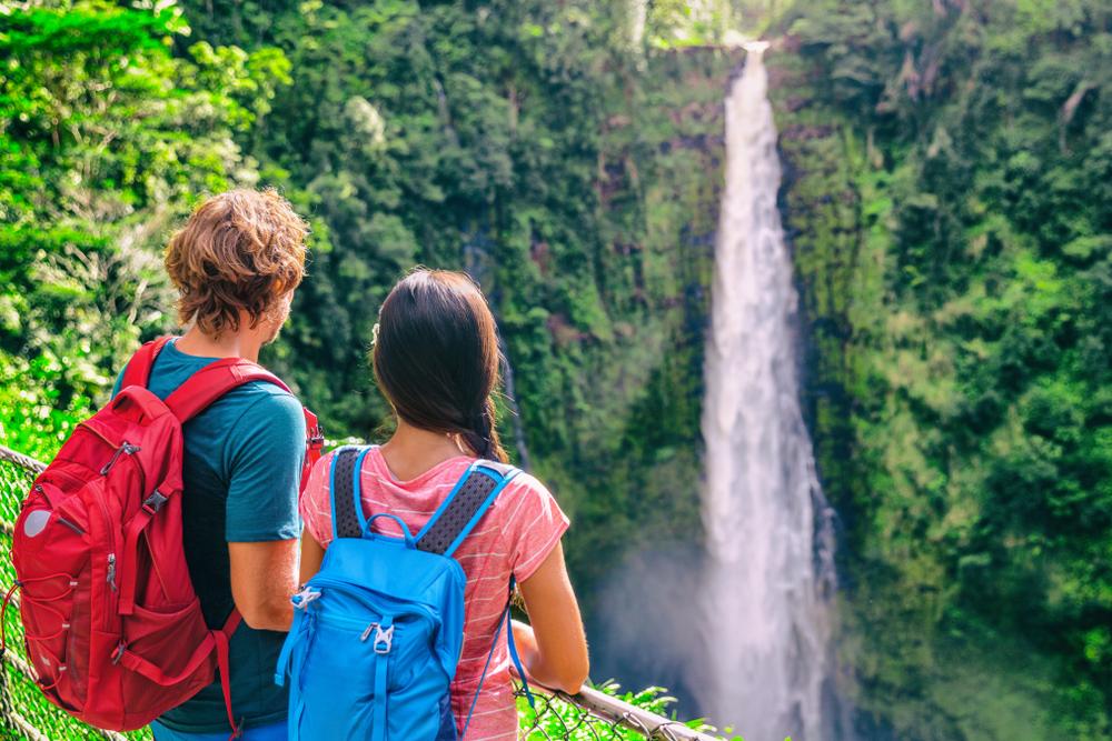 tourists exploring the beautiful waterfall